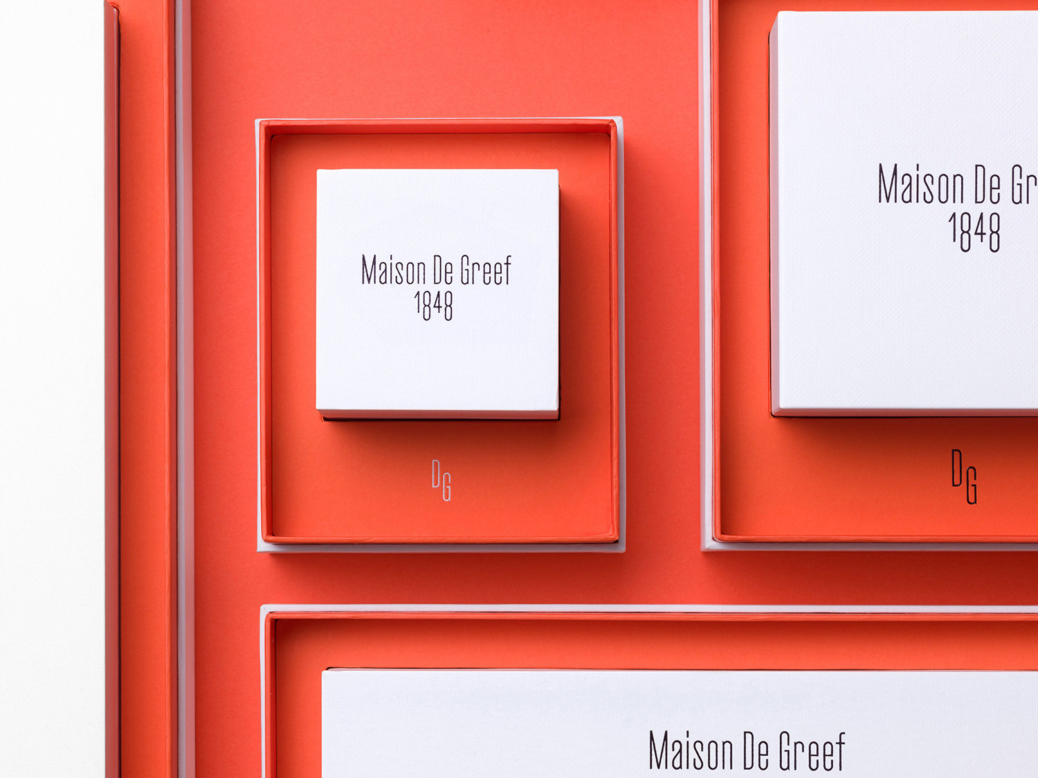 Logo and packaging by Base Design for high-end jewellery brand, expert watchmaker and retailer Maison De Greef 1848