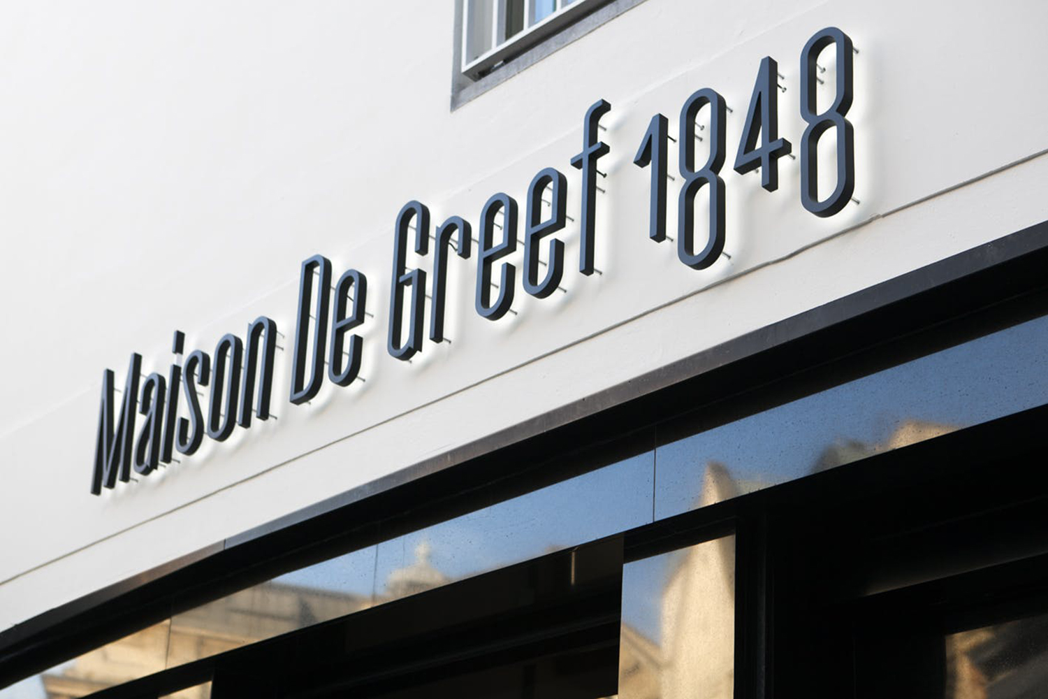 Logotype and signage by Base Design for high-end jewellery brand, expert watchmaker and retailer Maison De Greef 1848