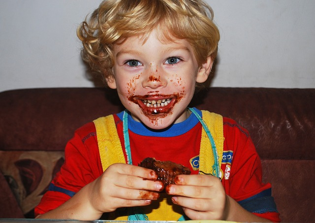 Smiling Child With Chocolate On His Face
