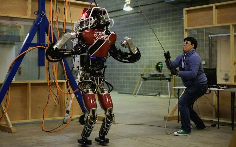 Atlas, a humanoid robot made by Boston Dynamics, can run on different types of surfaces