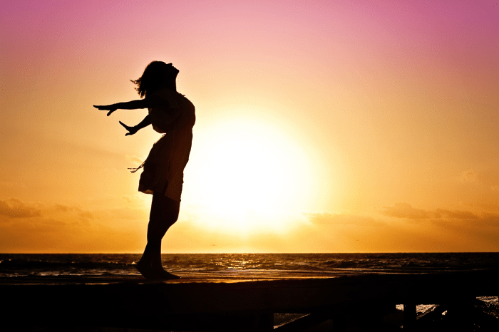 Woman stretching in front of sun set