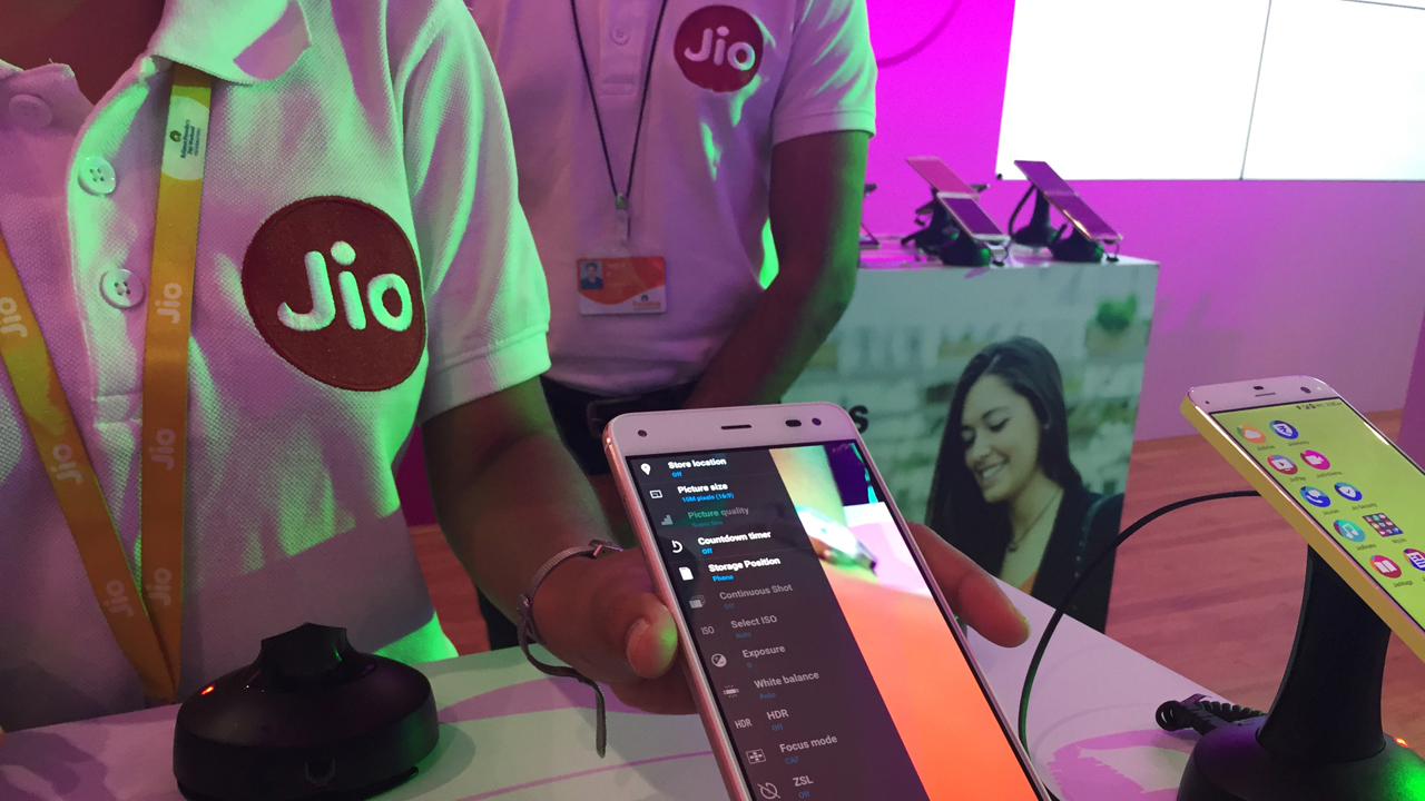A Reliance employee demonstrates Jio LYF phone at their headquarters on the outskirts of Mumbai