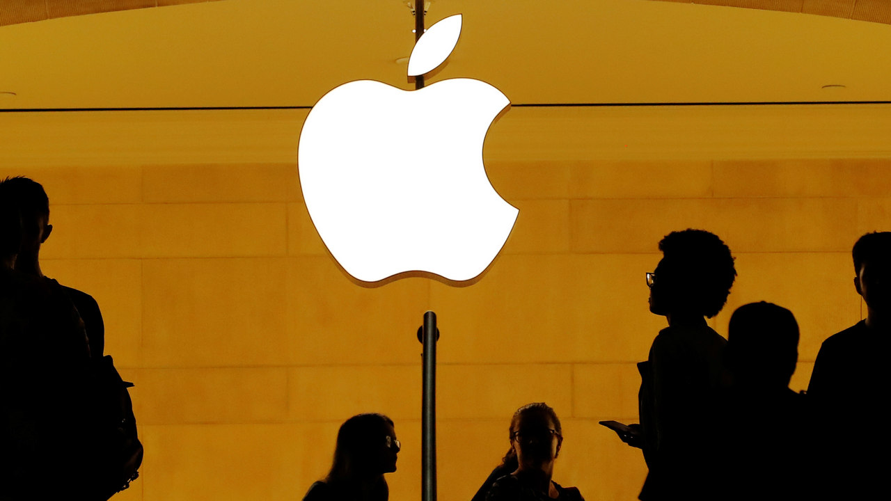 Customers walk past an Apple logo inside of an Apple store at Grand Central Station in New York, US. Image: Reuters