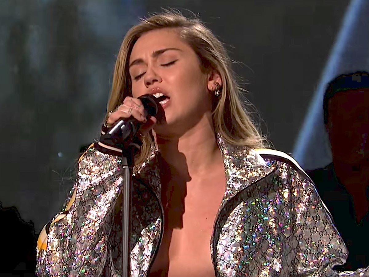 Cyrus wore her Gucci jacket unzipped with nothing underneath.