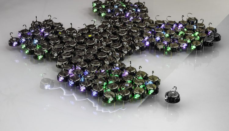 Growing bio-inspired shapes with a 300-robot swarm