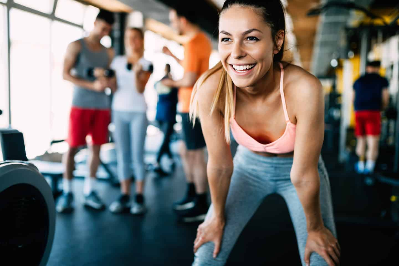 fitness instructor smiling after gym workout