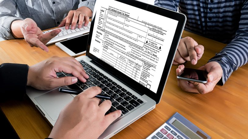 Preparing For Taxes 1040 Form Laptop